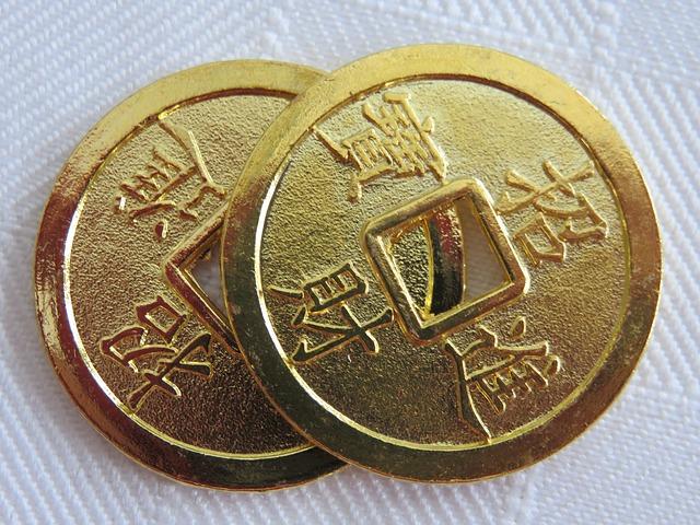 dvě asijské mince pro štěstí